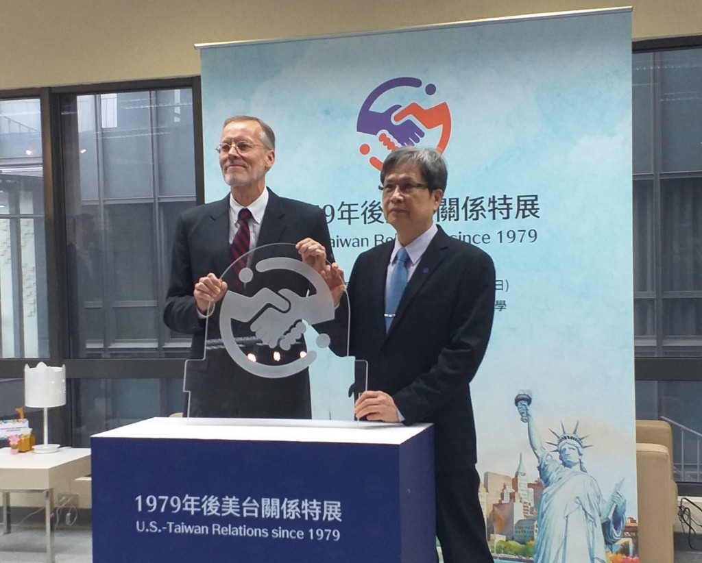 AIT Director Brent Christensen (left) and National Taipei University President Lee Chen-jai.