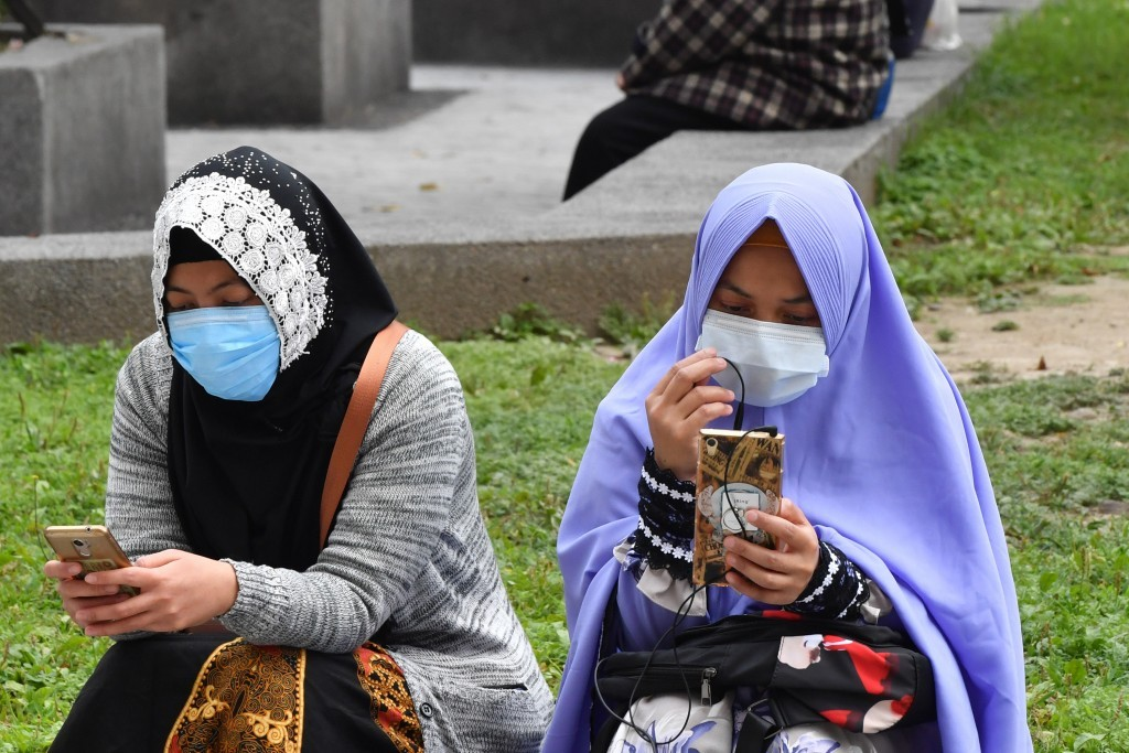 Migrant workers in Taiwan wearing masks against the coronavirus