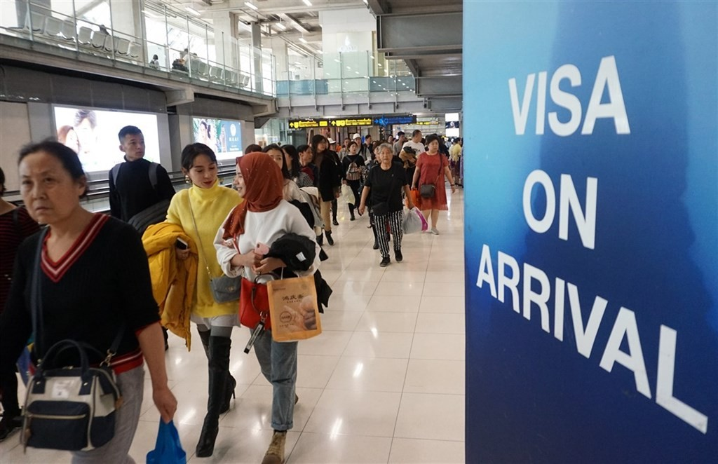 Travelers at a visa-on-arrival line in Thailand