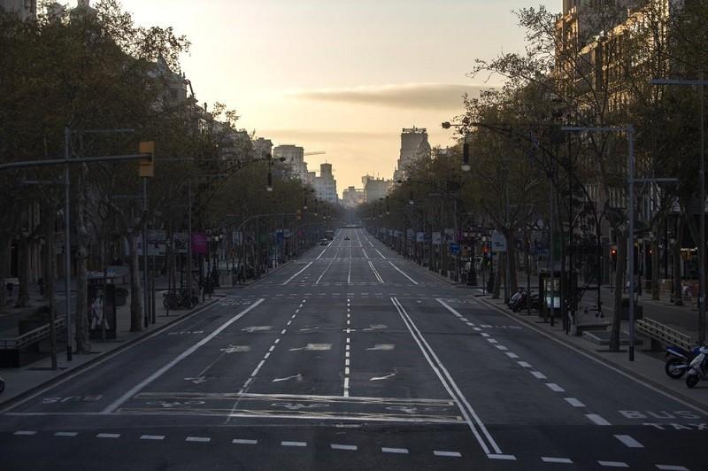 An avenue is seen empty in Barcelona, Spain, Sunday, March 15, 2020.