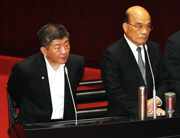Taiwan Health Minister Chen Shih-chung (left) reports at Legislative Yuan.