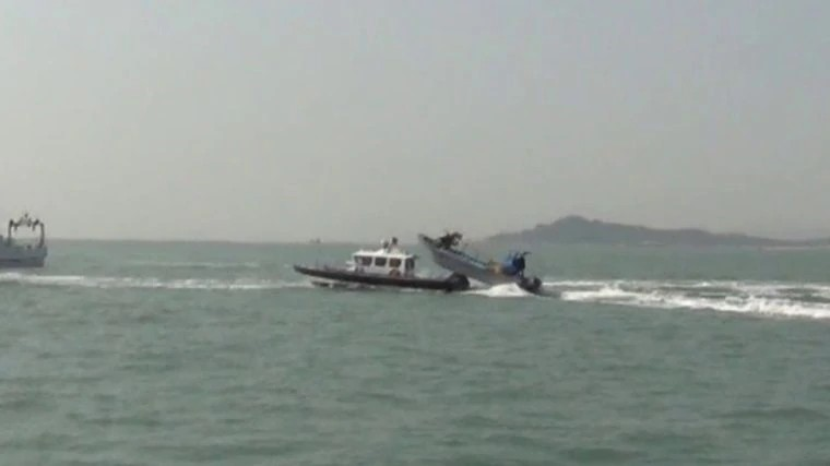 Taiwanese cutter (left) being rammed by Chinese boat (right). (CGA image)