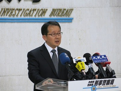 CIB spokesperson speaks at a press conference.