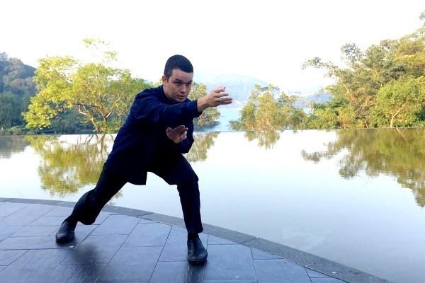 Blohm striking kung fu pose at Sun Moon Lake. (Mark Blohm photo)