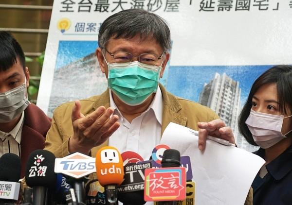 Taipei Mayor Ko Wen-je interviewed by media March 30.