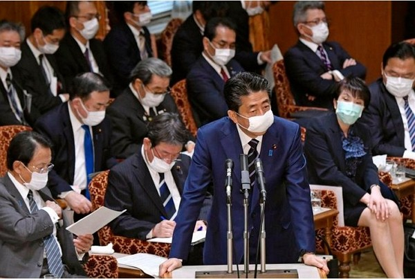Japanese Prime Minister Shinzo Abe (center).