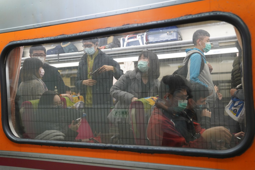 Train packed with passengers heading out for Qingming holiday.