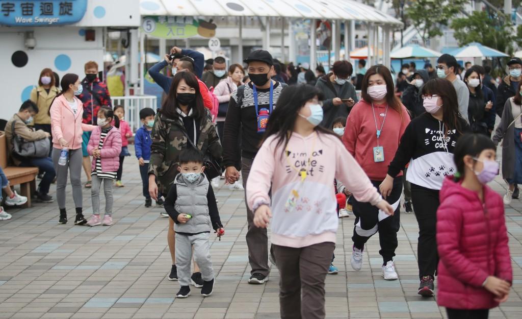 Visitors at an amusement park on April 4