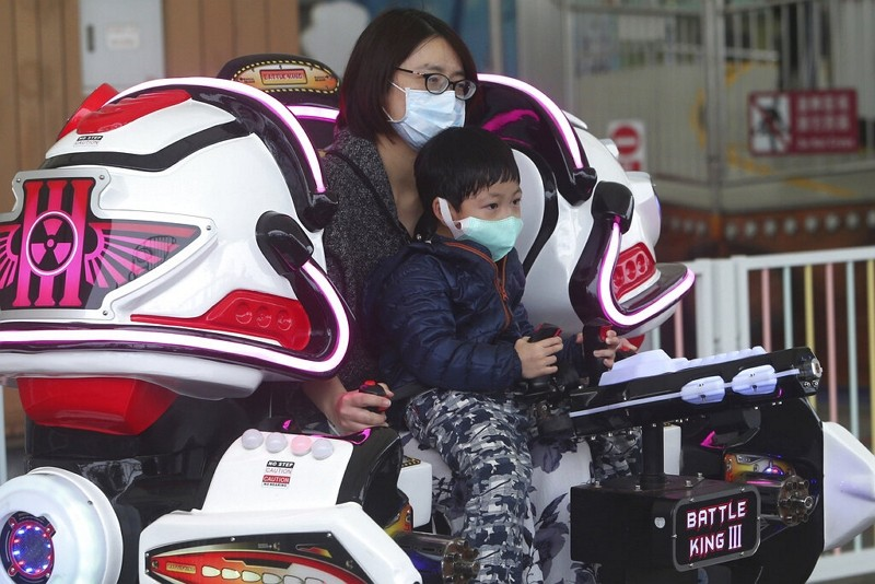 Visitors wear face masks to protect against the spread of the new coronavirus at Taipei Children's Amusement Park.