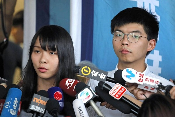 Hong Kong activists Agnes Chow (left), Joshua Wong (right).