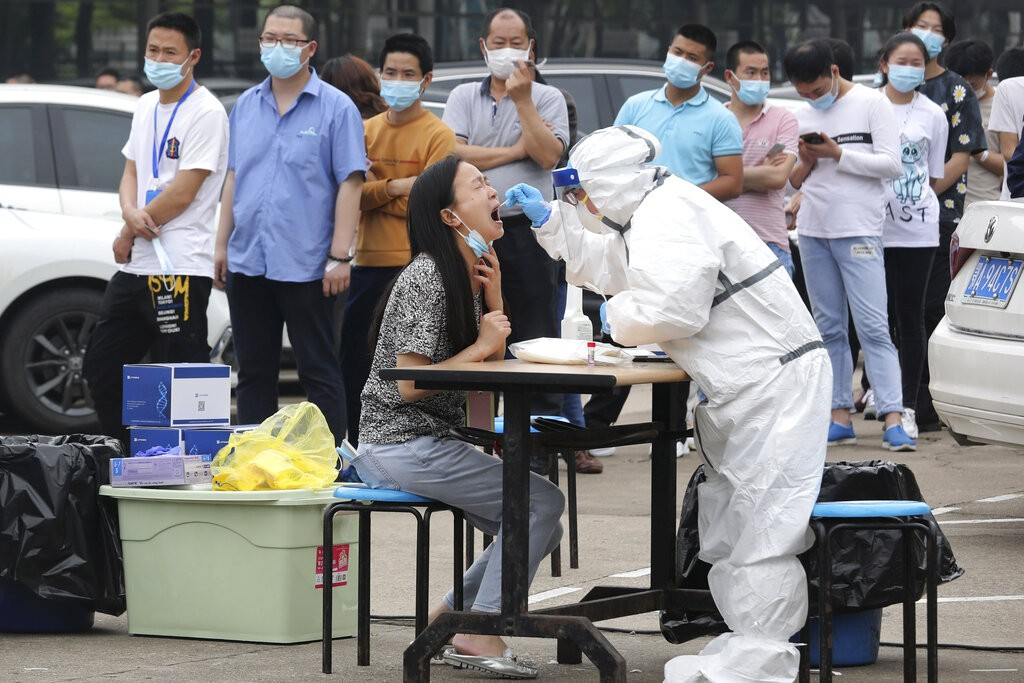 Wuhan woman being tested for coronavirus.