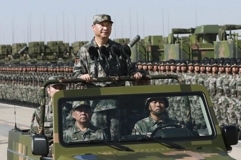 Chinese Chairman Xi Jinping (center).