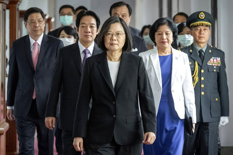 Taiwanese President Tsai Ing-wen, center, walks ahead of Vice-President William Lai, left of her, as they attend an inauguration ceremony in Taipei, M...