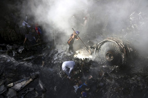 An aviation official says a passenger plane belonging to state-run Pakistan International Airlines carrying nearly 100 passengers and crew crashed nea...