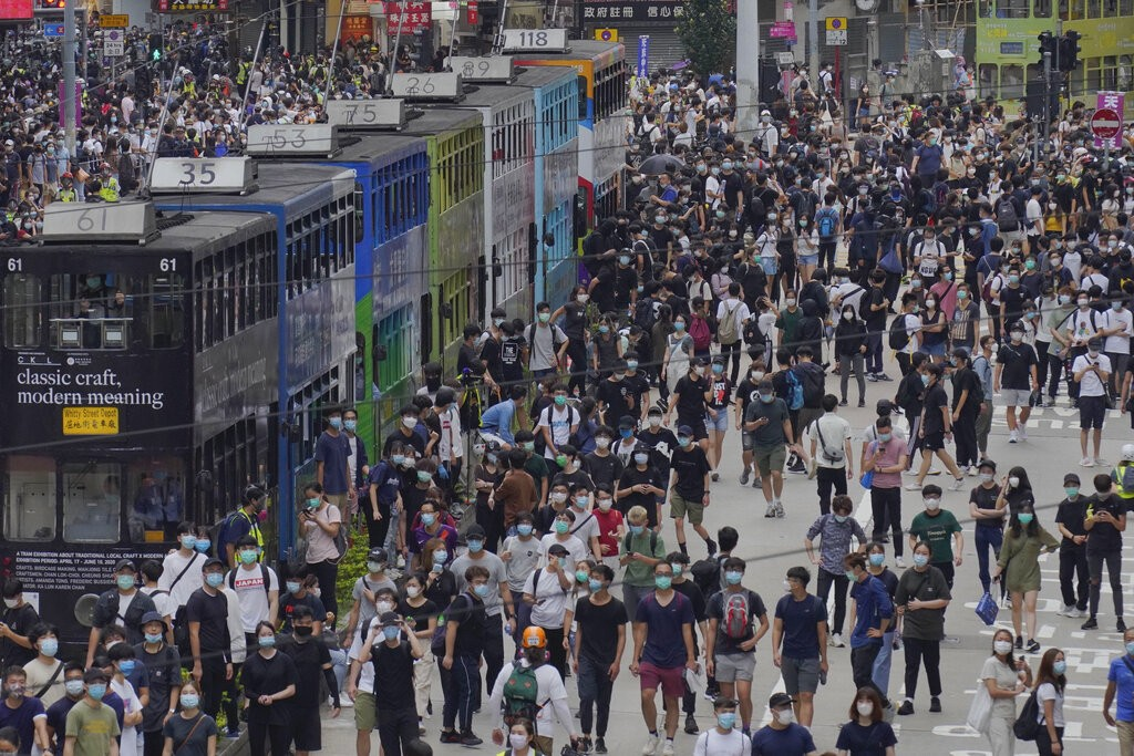 Hong Kong pro-democracy protesters take to streets on May 24 to protest against Beijing's proposed security law.