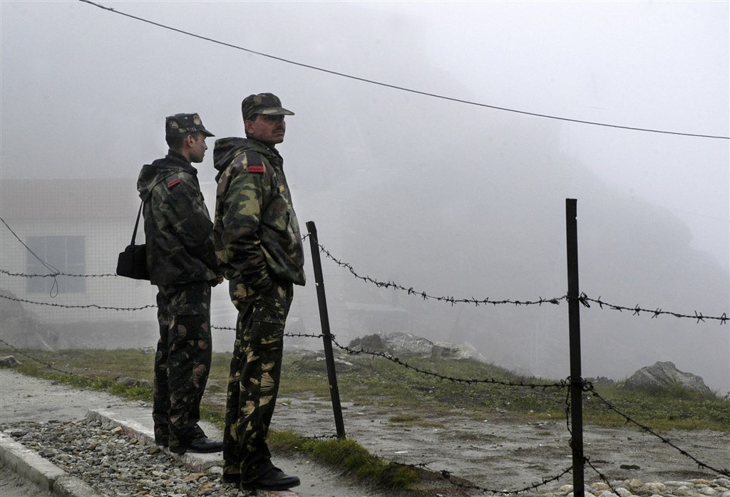 Indian troops stand guard at Nathu La Pass