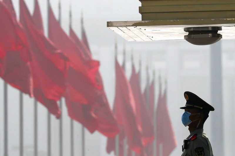 A Chinese paramilitary policeman stands guard near Tiananmen Square before the opening session of China's National People's Congress.