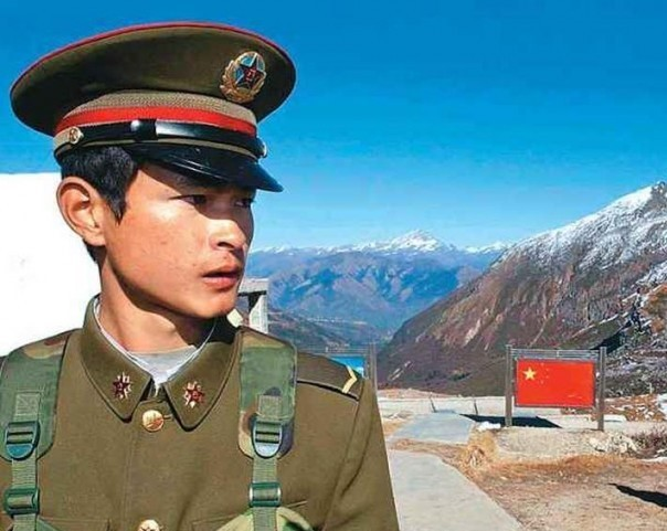 A Chinese soldier stands guard near the Indian border.