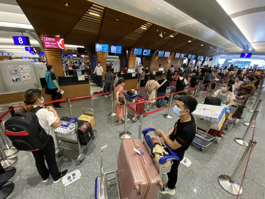 Vietnamese checking in for a charter flight home at Taiwan Taoyuan International Airport May 29