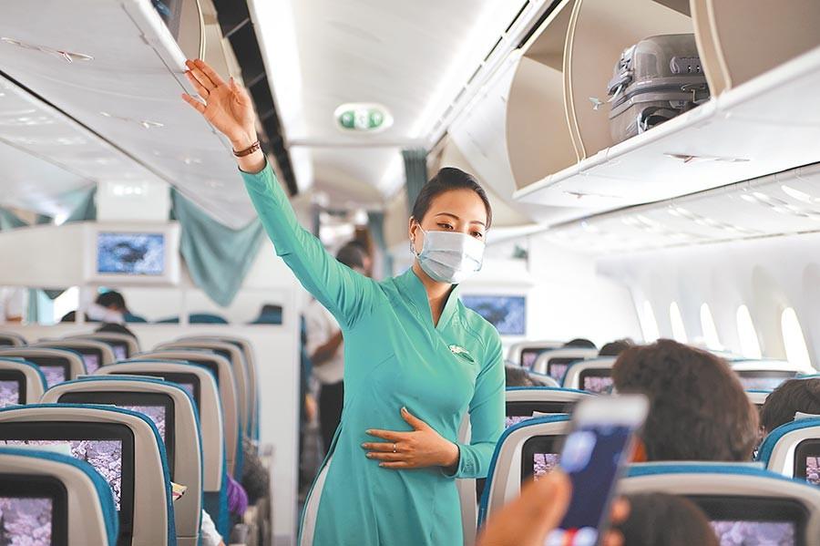 Vietnam Airlines flight attendant wearing face mask.