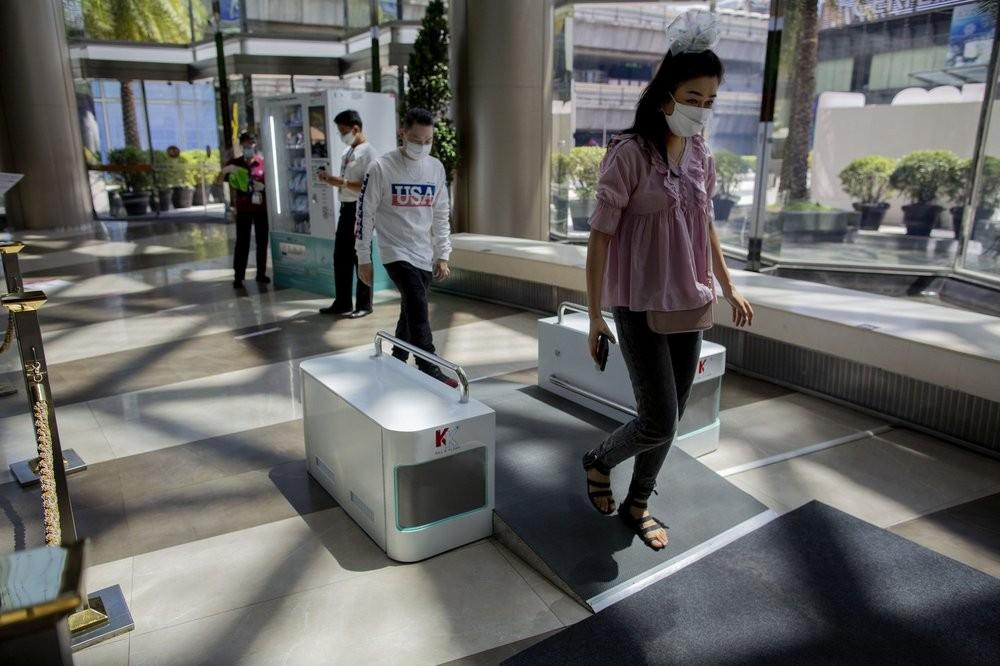 Visitors entering a Bangkok shopping mall