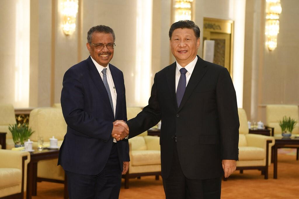 Tedros Adhanom (left), Xi Jinping (right).