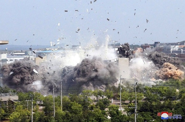 This photo provided by the North Korean government shows the demolition of an inter-Korean liaison office building in Kaesong, North Korea, Tuesday, J...