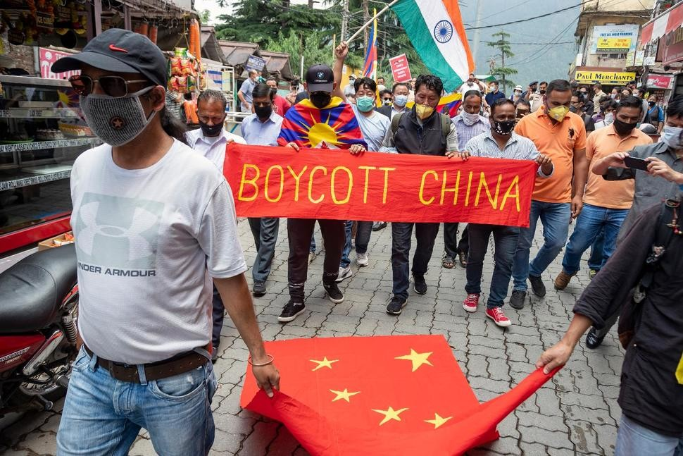 Exiled Tibetans and local Indians protest against the Chinese government.