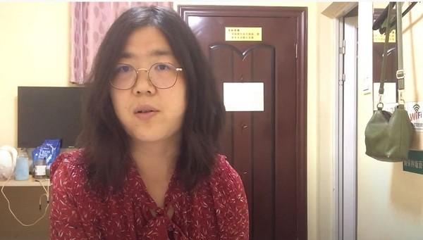 "Zhang in Wuhan before her arrest (<a href=""https://www.youtube.com/channel/UCsNKkvZGMURFmYkfhYa2HOQ/videos"" target=""_blank"">張展</a> Youtube screenshot)"