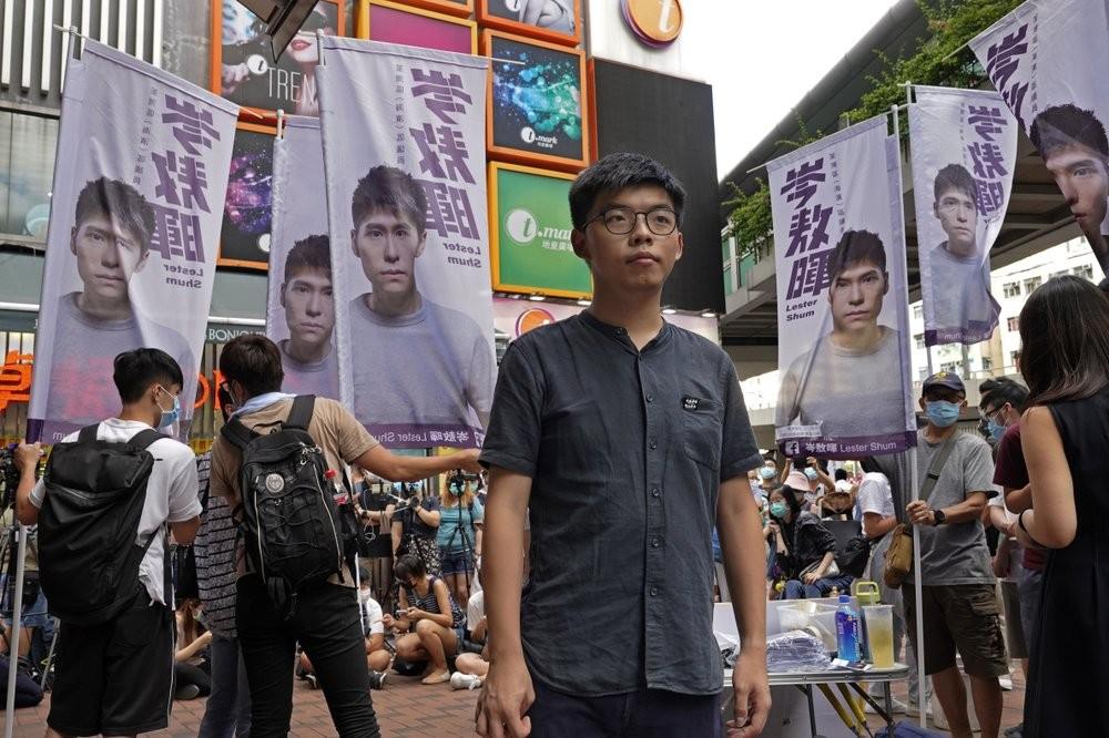 Hong Kong activist Joshua Wong (center) at a political event on June 20