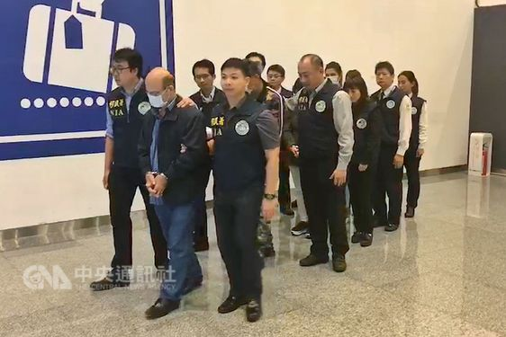 File photo of arrested human traffickers at airport