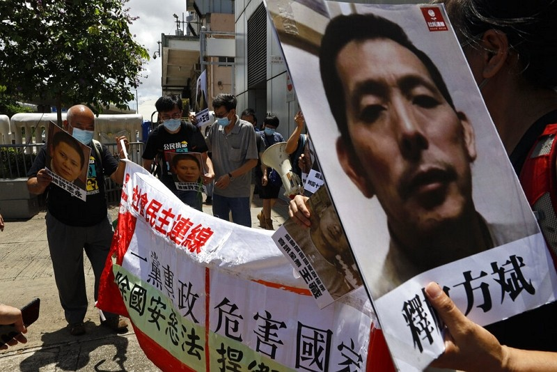 Pro-democracy demonstrators march to the Chinese liaison office in Hong Kong,June 25, 2020.
