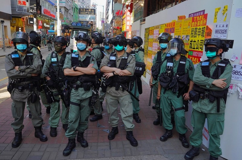 Police officers stand guard as people gather to protest against Beijing's national security law in Hong Kong,June 28, 2020.