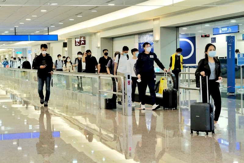 First batch of 107 foreigners arrive as Taiwan opens doors to visitors