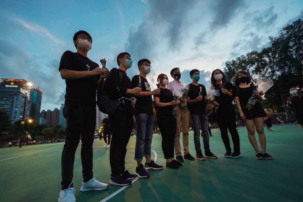 "<a href=""https://www.facebook.com/demosisto/"" target=""_blank"">Demosistō</a> members lined up with candles for Hong Kong's democracy on June 4, 2020.  (Facebook, Demosistō photo)"
