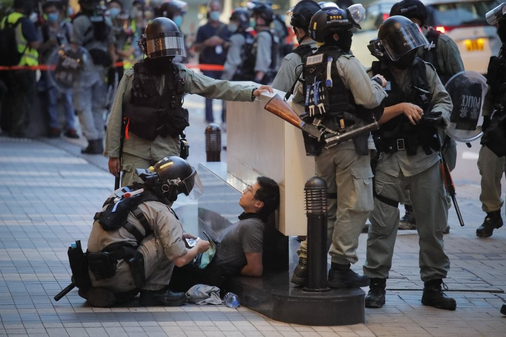 Police detain protester in Hong Kong on July 1.