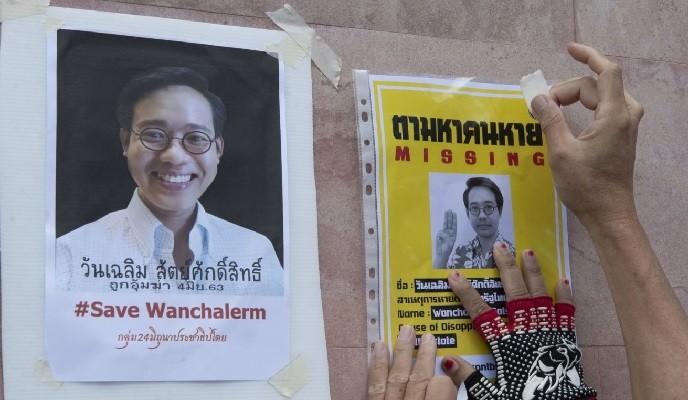 Activists put up posters near Cambodian embassy in Bangkok.