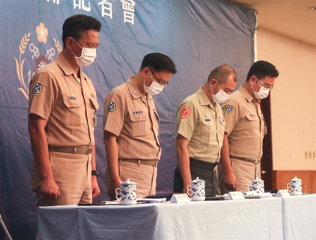 Taiwanese Navy officials hold one minute of silence at Monday's press conference
