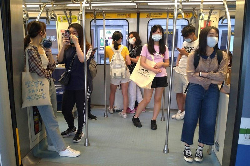 Passengers wear face masks to protect against the spread of the coronavirus aboard atrain in Taipei onJune 27.