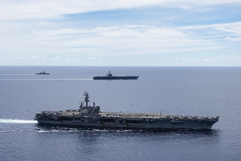 USS Ronald Reagan (CVN 76, front) and USS Nimitz (CVN 68, rear) Carrier Strike Groups sail together in the South China Sea, July 6, 2020.