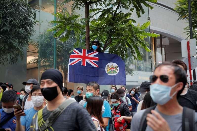 Man displays Hong Kong colonial flag onanniversary of Hong Kong's handover to China from Britain.
