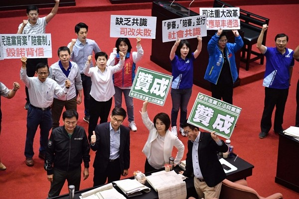 Legislative Yuan passes Citizen Judges Act to allow participation of citizens in criminal trials.