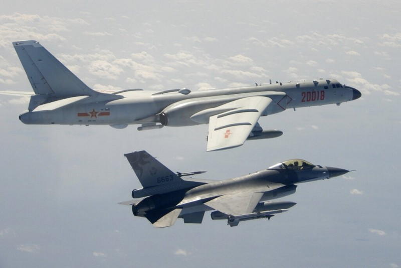 A Taiwanese Air Force F-16 in foreground flies on the flank of a Chinese PLAAFH-6 bomber as it passes near Taiwan. (Taiwan's MND via AP&nbsp...