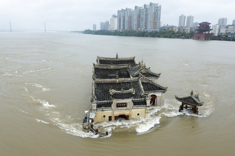 Kwanyin temple built on a rocky island in the middle of the Yangtze River is seen flooded on Sunday (July 19).