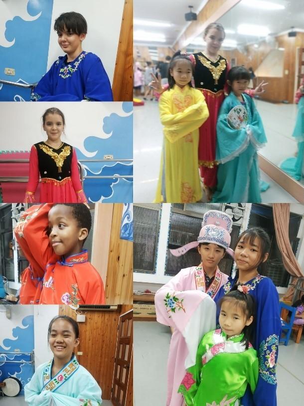 說明:多國的新住民二代和臺灣多族原住民學童著各國傳統服裝(宜萱婦幼關懷協會提供)