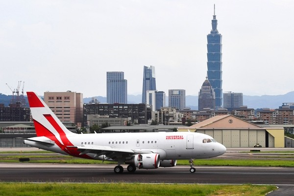 Chartered plane carrying Japanese delegation lands in Taipei's Songshan Airport.