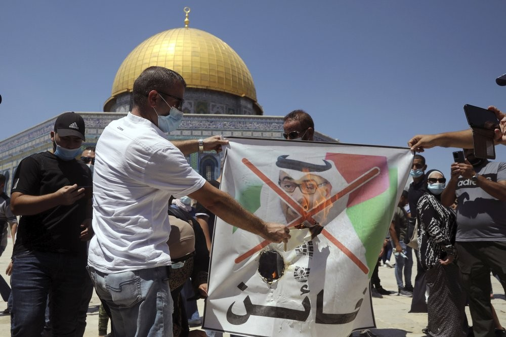 Palestinians burn pictures of U.S. President Donald Trump, Abu Dhabi Crown Prince Mohammed bin Zayed al-Nahyan and and Israeli Prime Minister Benjamin...