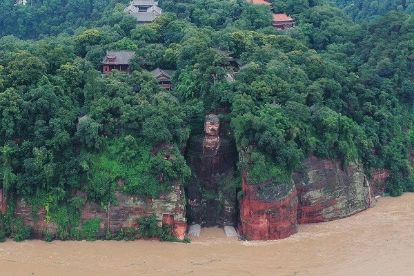 Floodwaters reach the feet of the Leshan Giant Buddha. (Reuters photo)