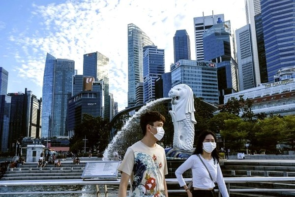 Individuals wearing protective masks in Singapore.