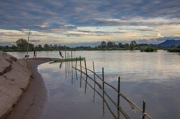 Children play at sunset in Laos'Si Phan Don (4,000 islands)in Mekong River.